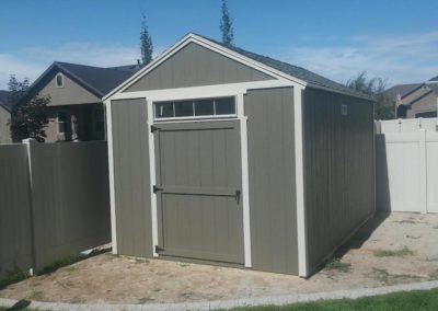 Gray Orchard Shed with Transom Window over Door