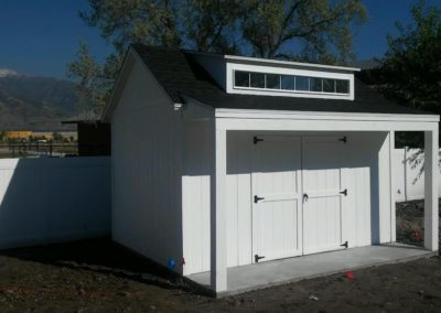 White Orchard Shed with Popout Porch and Deck